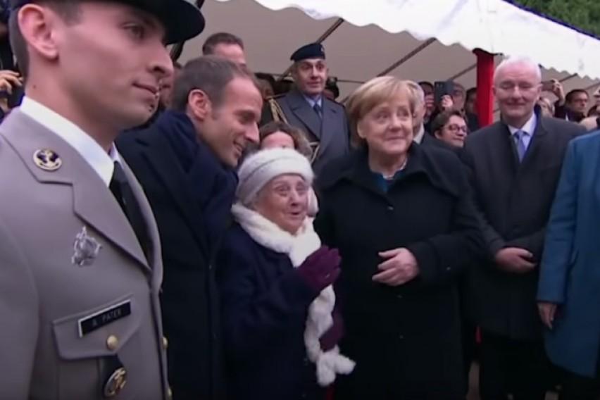 СЛУШНАЛА ДЕКА ИМА ПОСТАРА ЖЕНА: 101-годишна госпоѓа ја прашува Меркел дали му е сопруга на Макрон (ВИДЕО)